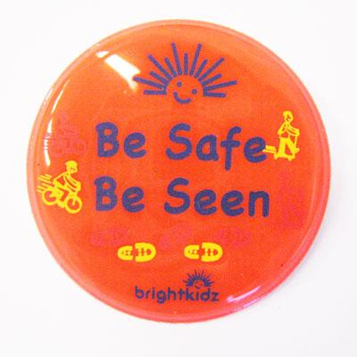 orange be safe be seen reflective pin badge