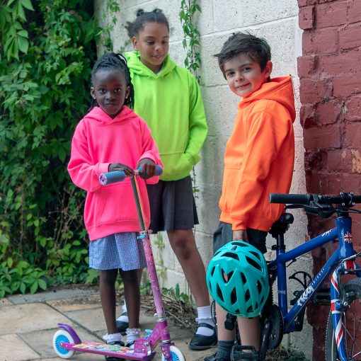 neon hoodies worn by three kids