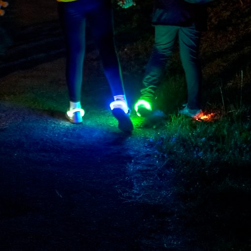 LED shoe clips at night in use