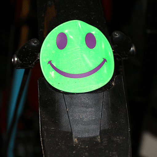 green stick on reflective smile on bike