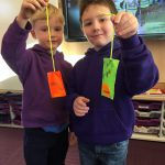 Boys holding fluorescent tags