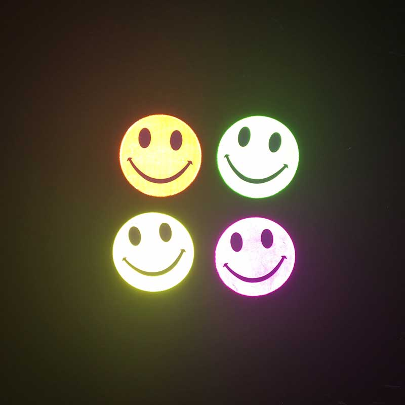 reflective smiles stick ons at night