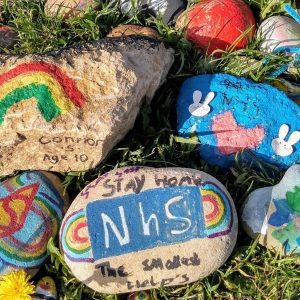 painted stones with NHS message