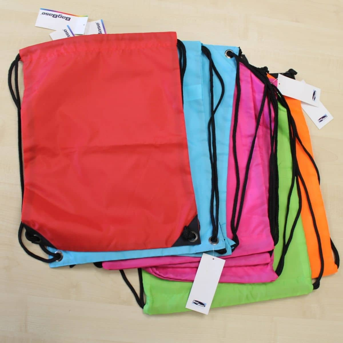 Pile of drawstring bags in different colours