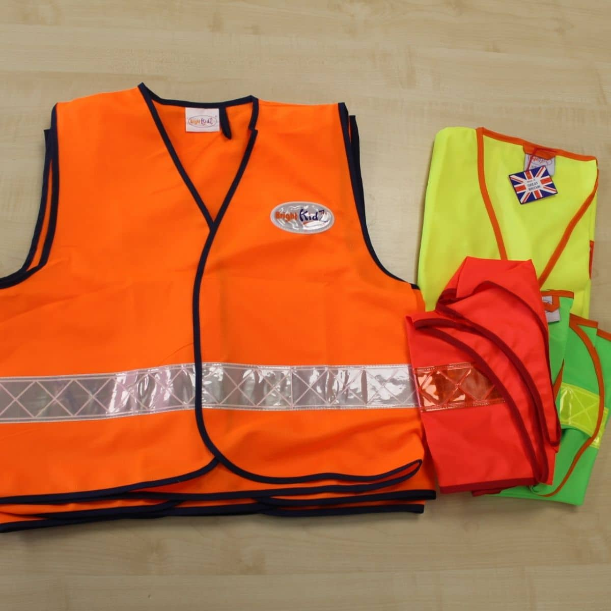 Pile of Hi Vis waistcoats in orange, red, green and yellow
