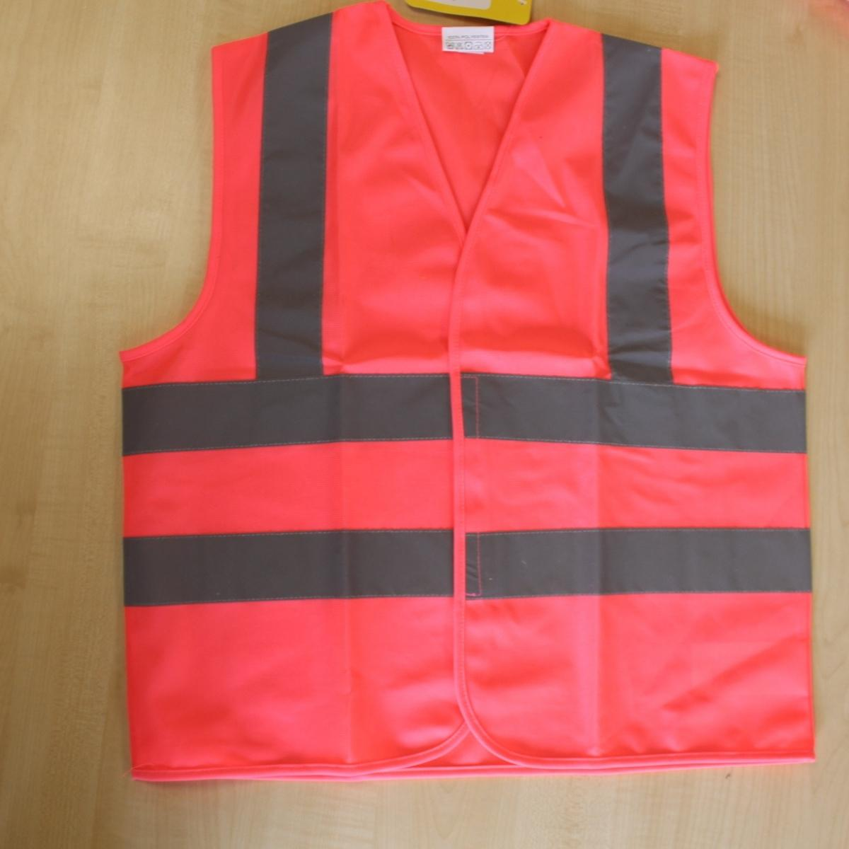Pink Waistcoat with reflective bands over shoulders